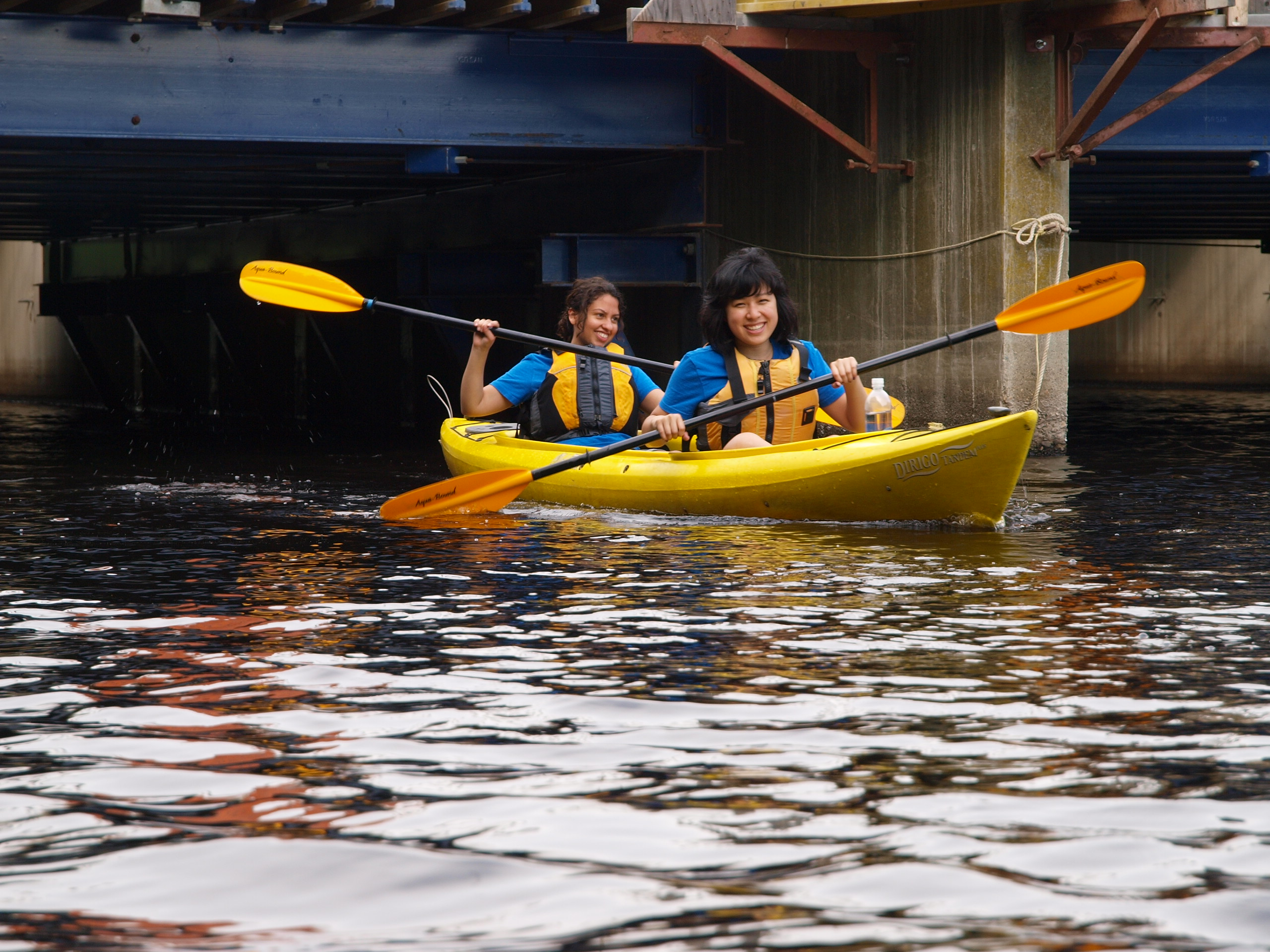 Emily_and_Sofia_making_their_way_along_the_Charles_River_in_their_kayak._(7374951574)